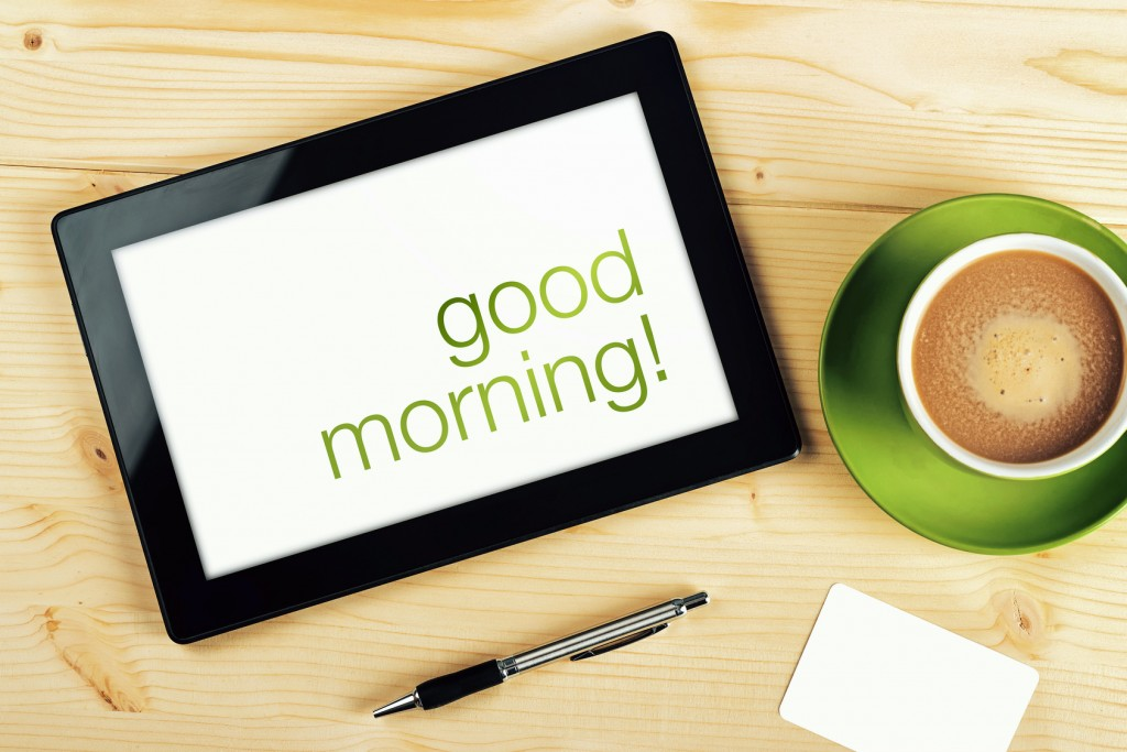 Good Morning Message on Tablet Computer Screen on Office Table.