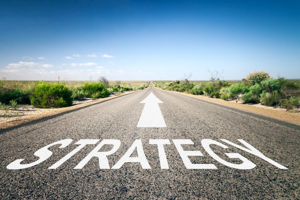 An image of a road to the horizon with text strategy