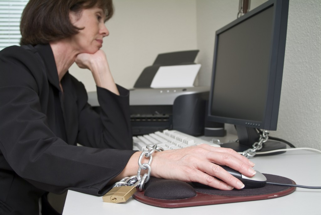 Woman chained to her desk
